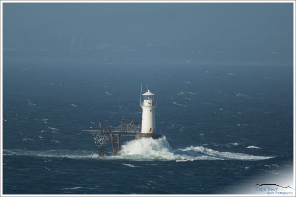 The Cape Town Downwind passes the Iconic Roman Rock Lighthouse. Just about halfway on the Miller's Run